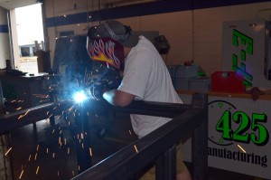 Welding and fabricating a custom welding table.